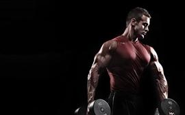 Hombre, músculo, pesas, fondo negro