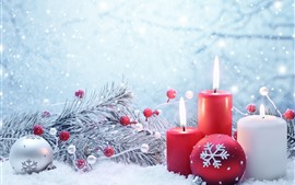 Red and white candles, flame, snow, Christmas balls