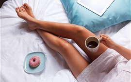 Preview wallpaper Girl legs, coffee, donut, bed