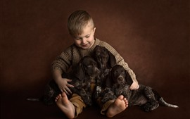 Preview wallpaper Little boy and three puppies