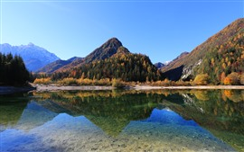 Mountains, trees, autumn, lake, clear water