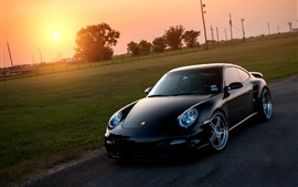 Preview wallpaper Porsche 911 black supercar at sunset