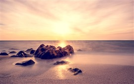 Rocks, sands, sea, fog