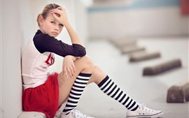 Preview wallpaper Young girl, sneakers, sit on ground