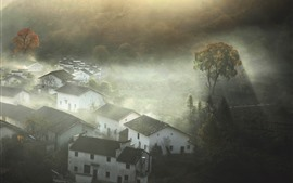 Beautiful village in morning, sun rays, trees, Shicheng, China