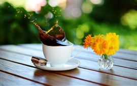 One cup of coffee, splash, yellow flowers