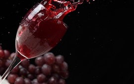 Preview wallpaper Red wine splash, glass cup, grapes, black background
