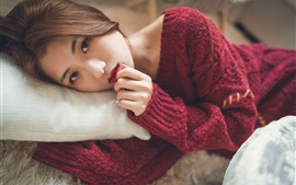 Preview wallpaper Asian girl look at you, red sweater, bed