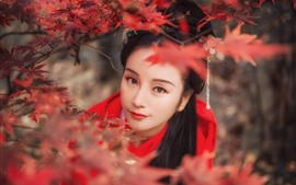 Beautiful girl look at you, retro style, red maple leaves