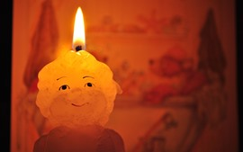 Candle, flame, smiley face