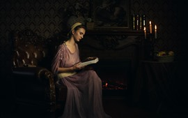Preview wallpaper Retro style girl, read book, fireplace, candles, books