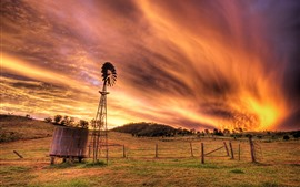 Preview wallpaper Sky, clouds, sunset, grass, windmill