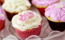 Preview wallpaper Some cupcakes, flowers, cream, food