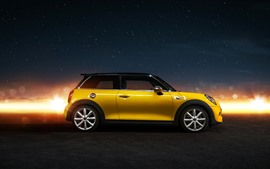 Yellow Mini Cooper car side view