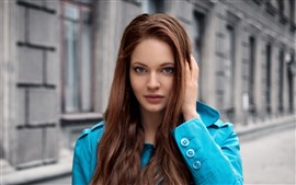 Brown hair girl, blue coat