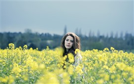 Preview wallpaper Girl in rapeseed flowers field