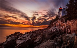 Preview wallpaper Lighthouse, rocks, sea, sunset, sky, clouds