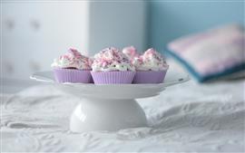 Some cupcakes, cream, bed, hazy