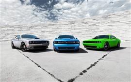 Carros esportivos Dodge de três cores