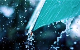 Preview wallpaper Blue umbrella, water splash, rainy day