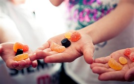 Colorful jellies candy, hands