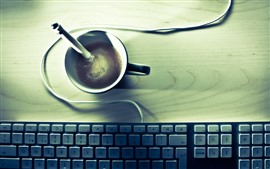 One cup coffee, keyboard