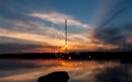 Étincelles, gitter, coucher de soleil