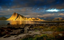 Preview wallpaper Stones, sea, clouds, mountains, dusk