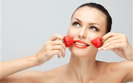 Preview wallpaper Fashion girl, two strawberries, face, hands, smile