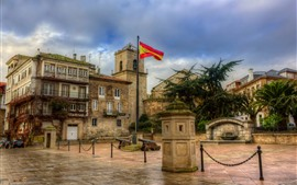 Preview wallpaper Spain, square, city, houses, flag, clouds