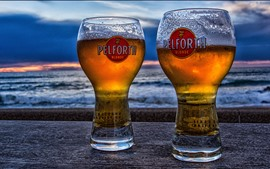Two cups beer, sea, dusk