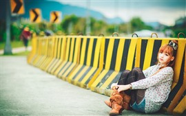 Preview wallpaper Young Asian girl, sit on the road