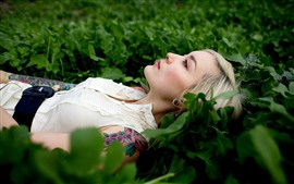 Preview wallpaper Blonde girl, rest, green grass