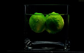 Preview wallpaper Glass cup, green limes in the water