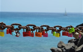 Preview wallpaper Many locks, chain, rusty, sea