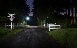 Preview wallpaper Night, road, crossroad, railway, lights, trees, fence