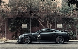 Preview wallpaper Nissan GT-R black supercar side view, wire fence
