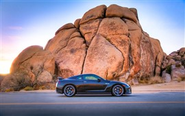 Preview wallpaper Nissan GT black car, rocks