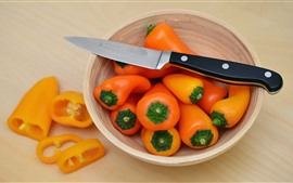 Preview wallpaper Orange peppers, bowl, knife