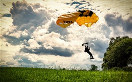 Paraglider, man, grass, clouds