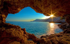 Preview wallpaper Sea, hole, sun rays, dusk
