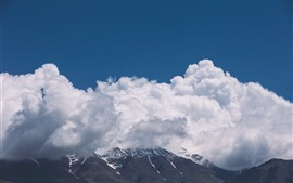 Preview wallpaper Thick white clouds, mountains, sky