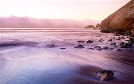 Preview wallpaper Coast, beach, rocks, sea, sun rays, morning, fog