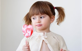 Preview wallpaper Cute little girl and candy