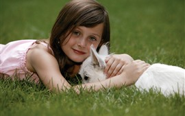 Preview wallpaper Cute little girl and white dog, grass