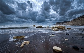 Preview wallpaper Dark clouds, coast, sea, rocks