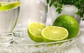 Green lemon, glass plate