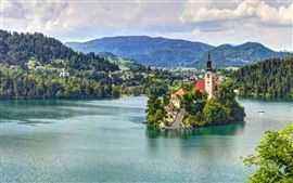 Preview wallpaper Slovenia, lake, island, church, mountains, clouds