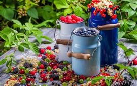 Three bucket of berries, raspberries, blueberries, red currants