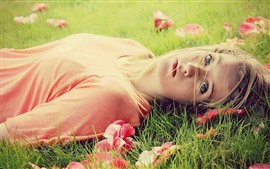 Preview wallpaper Blonde girl, lying on grass, look